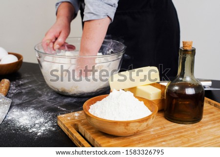 chef prepares the ingredients for making buns. dough preparation process. #1583326795