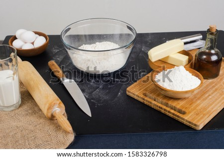 chef prepares the ingredients for making buns. dough preparation process. #1583326798