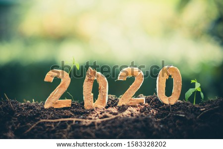 Happy New Year 2020 social media video.2019-2020 change background new year resolution concept.wood text on ground.Perfect for your invitation or office card Royalty-Free Stock Photo #1583328202
