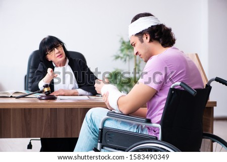 Disabled man consulting judge for damages litigation #1583490349
