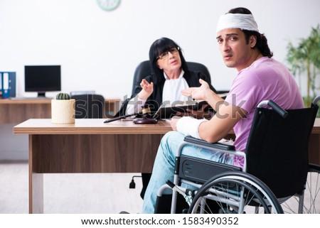 Disabled man consulting judge for damages litigation #1583490352