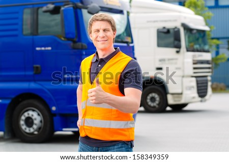 Logistics - proud driver or forwarder in front of trucks and trailers, on a transshipment point #158349359
