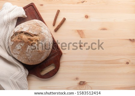 Hot bread on a table made of wood.  Template with place for text.  Flat lay. #1583512414