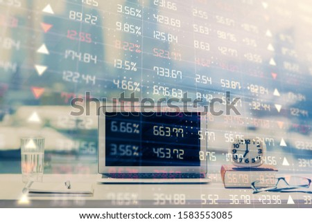 Forex Chart hologram on table with computer background. Double exposure. Concept of financial markets. #1583553085