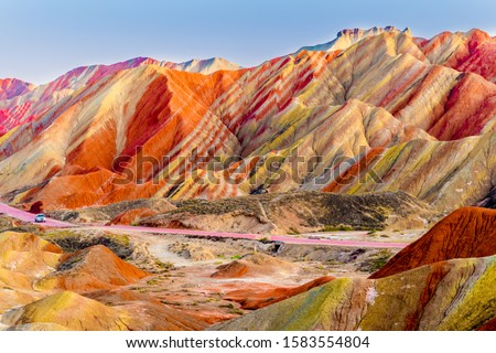 Amazing scenery of Rainbow mountain and blue sky background in sunset. Zhangye Danxia National Geopark, Gansu, China. Colorful landscape, rainbow hills, unusual colored rocks, sandstone erosion #1583554804
