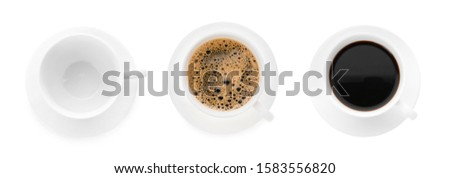 One empty cup and two cups of coffee on white background #1583556820