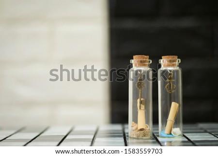 Tiny boat anchor and tiny keys in tiny glass bottles #1583559703