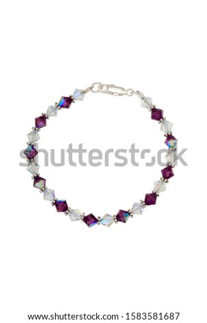 Red and clear bicone dichroic crystal beads and silver findings make up this bead bracelet. Shown on a white background. #1583581687