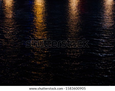 Background of lights reflected in river water #1583600905