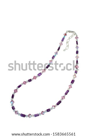 Irregular shape polished amethyst beads, bicone pink and clear dichroic crystals and silver findings make up this bead necklace. Shown on a white background. #1583665561