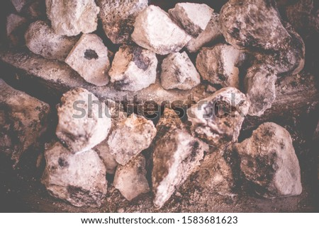 """Close up of stone oven , """"Barbacoa"""" refers to meats or whole sheep or whole goats slow-cooked over open fire or, more traditionally, in a hole dug in the ground covered with agave (maguey) leaves #1583681623"""