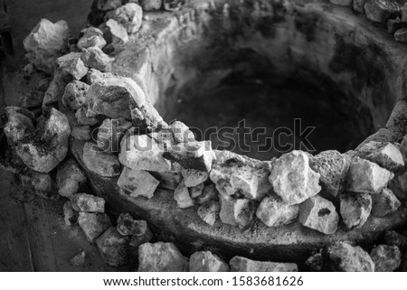 """Close up of stone oven , """"Barbacoa"""" refers to meats or whole sheep or whole goats slow-cooked over open fire or, more traditionally, in a hole dug in the ground covered with agave (maguey) leaves #1583681626"""