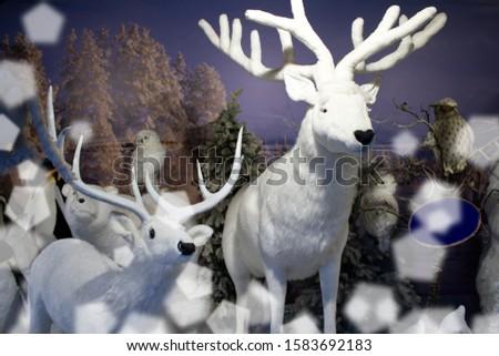 Big plush deer, reindeer, roebuck, bears and owls in snowy landscape. Winter scenery.Animals in winter landscape. Roe deer and deer.  Plush animal models. #1583692183