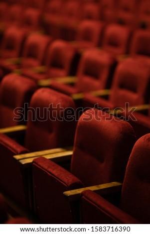 red velvet seats for spectators in the theater or cinema #1583716390