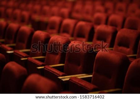 red velvet seats for spectators in the theater or cinema #1583716402