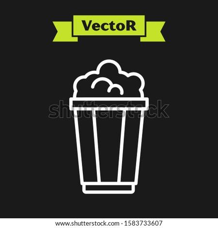 White line Popcorn in cardboard box icon isolated on black background. Popcorn bucket box.  Vector Illustration #1583733607