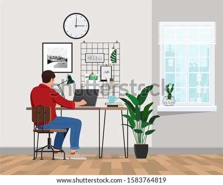 A freelancer man works behind a laptop. Home office workplace. #1583764819