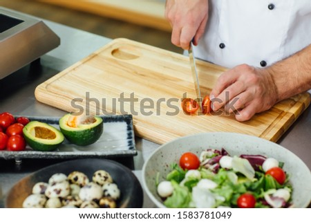 Chef cooking food kitchen restaurant, cutting cook hands, male knife preparation, fresh preparing concept, stock image. #1583781049