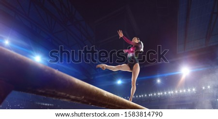 Female gymnast on professional arena. #1583814790