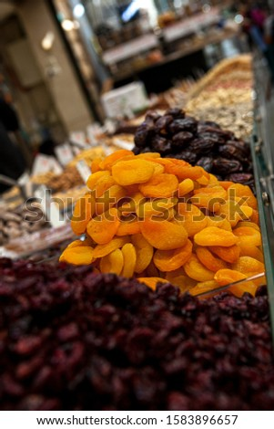 Mix of dried and sun-dried fruits, dried fruits in a wooden box on a white wooden background. View from above. Symbols of the Jewish holiday of Tu B'Shvat #1583896657