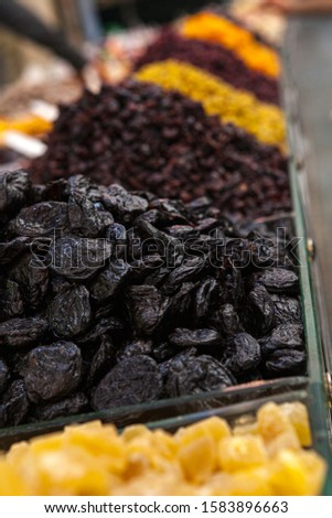 Mix of dried and sun-dried fruits, dried fruits in a wooden box on a white wooden background. View from above. Symbols of the Jewish holiday of Tu B'Shvat #1583896663