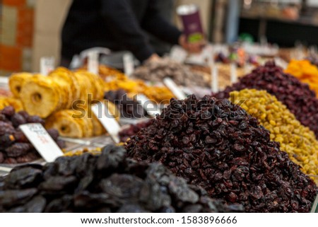 Mix of dried and sun-dried fruits, dried fruits in a wooden box on a white wooden background. View from above. Symbols of the Jewish holiday of Tu B'Shvat #1583896666