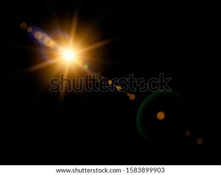 Optical sun flare on black background. Royalty-Free Stock Photo #1583899903