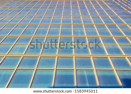 Big tall skyscraper with windows #1583945011