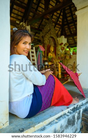 Thai woman with Lanna style background, Chiang Mai. #1583946229