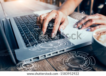 Businessman using laptop computer with Digital marketing media and virtual globe shape diagram. Business Financial icons graphs. #1583952922