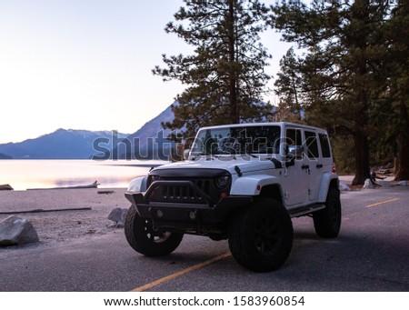 White SUV on a road trip adventure  #1583960854
