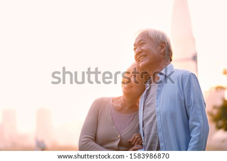 outdoor portrait of loving senior asian couple, happy and smiling #1583986870