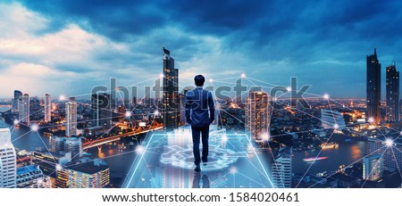 Business technology concept, Professional business man walking on future network city background and futuristic interface graphic at night, Cyberpunk color style #1584020461