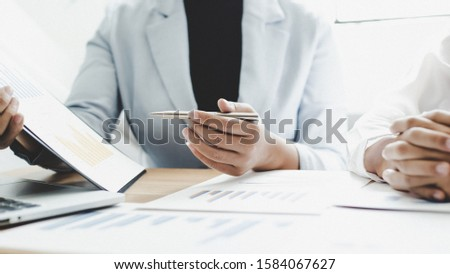 Meeting a team of businessmen, Executives and accountants meeting about the company's revenue graph in the office with laptops and calculators, Finance concept #1584067627