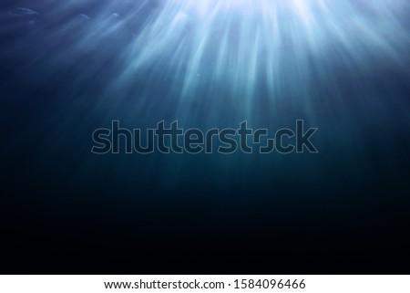 Aqua Menthe underwater surface sunlight shot sunlight shafts reaching to dark depths #1584096466