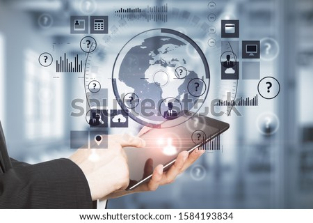 Hand holding digital tablet with abstract global network interface. Server and technology concept #1584193834