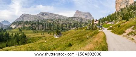 Dolomites - mountain tourism. Panoramas with visible Averau peak. #1584302008