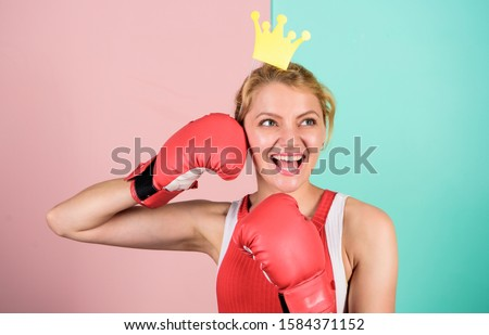 Athletic woman winner. Victory concept. Sport success. Achieve success. Celebrate success. Queen of boxing ring. Sportswoman with princess crown. Cheerful girl with crown prop in boxing gloves. #1584371152
