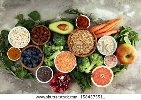 Healthy food clean eating selection: fruit, vegetable, seeds, superfood, cereals, leaf vegetable on background #1584375511