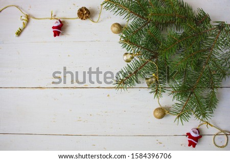 Christmas decoration from a Christmas tree branches and balls. Holiday Christmas background. Christmas card. Copyspace #1584396706