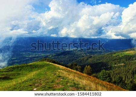 beautiful landscpae with cloud and blue sky. Particular landscape with the effect of the sun #1584411802