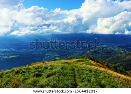 beautiful landscpae with cloud and blue sky. Particular landscape with the effect of the sun #1584411817