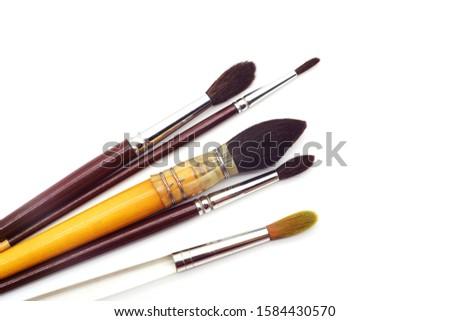 set of round artistic paintbrushes isolated on white background. Artist many paintbrushes. #1584430570