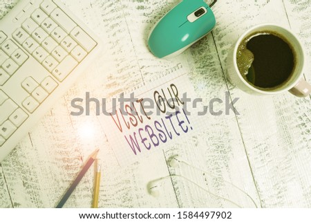 Text sign showing Visit Our Website. Conceptual photo visitor who arrives at web site and proceeds to browse technological devices colored reminder paper office supplies keyboard mouse. #1584497902