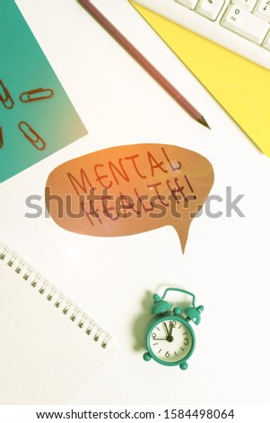 Writing note showing Mental Health. Business photo showcasing demonstratings condition regard to their psychological well being Red bubble copy space paper on the table with clock.