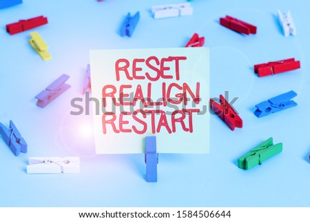 Word writing text Reset Realign Restart. Business concept for Life audit will help you put things in perspectives Colored clothespin papers empty reminder blue floor background office pin. #1584506644
