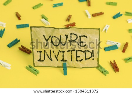 Handwriting text writing You Re Invited. Concept meaning make a polite friendly request to someone go somewhere Colored clothespin papers empty reminder yellow floor background office. #1584511372