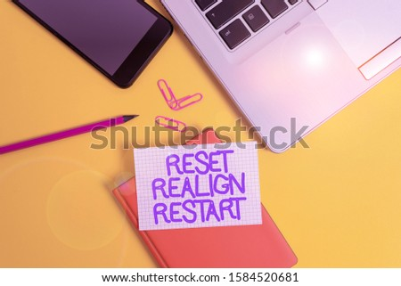 Conceptual hand writing showing Reset Realign Restart. Business photo showcasing Life audit will help you put things in perspectives Laptop smartphone clip pencil paper sheet colored background. #1584520681