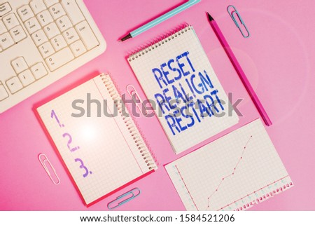 Handwriting text writing Reset Realign Restart. Concept meaning Life audit will help you put things in perspectives Writing equipments and computer stuffs placed above colored plain table. #1584521206