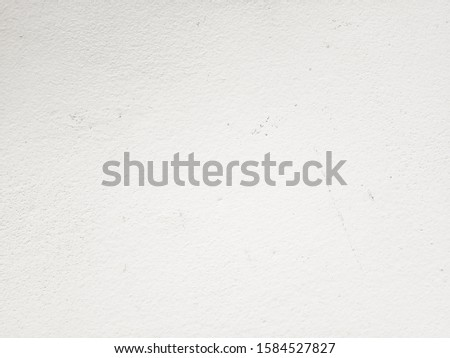White cement wall background in vintage style for graphic design or wallpaper. Pattern of soft concrete floor in retro concept. #1584527827